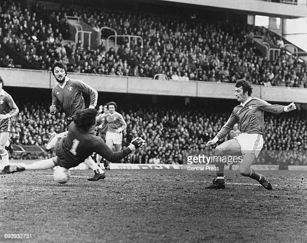 Nottingham Forest Forward Trevor Francis shoots the ball past a diving Chelsea goalkeeper Petar Borota and centre half Mickey Droy to score during...