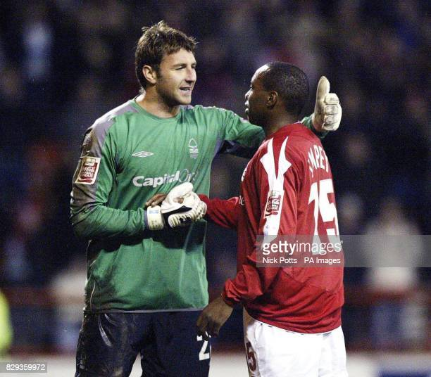 Nottingham Forest goalkeeper Paul Gerrard celebrates his penalty save with teammate Andrew Impey during the CocaCola Championship match against...
