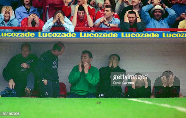 Nottingham Forest manager Brian Clough and fans react during the Premier League match against Sheffield United at the City Ground on May 1 1993 in...