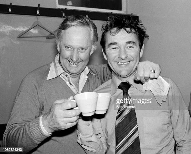 Nottingham Forest manager Brian Clough and his assistant Peter Taylor celebrate in the dressing room after the Football League Division One match...