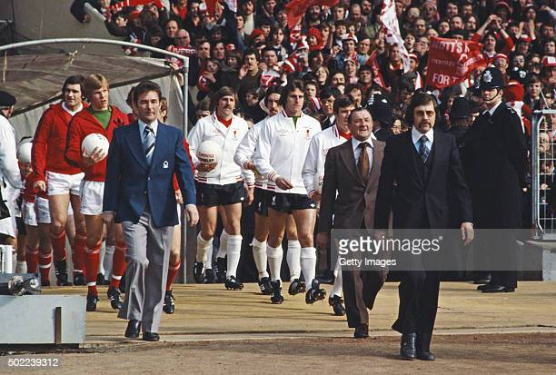 Nottingham Forest manager Brian Clough leads out his team as Liverpool boss Bob Paisley does likewise before the start of the 1978 League Cup Final...