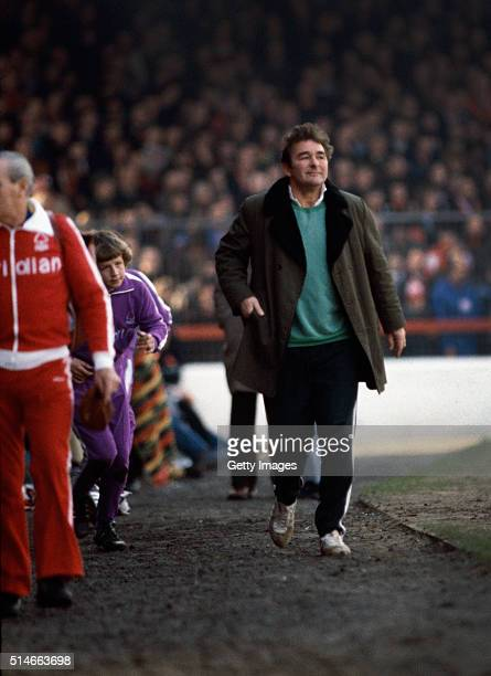 Nottingham Forest manager Brian Clough walks down the touchline to take his place in the dugout at the City ground before a match during the 1979/80...