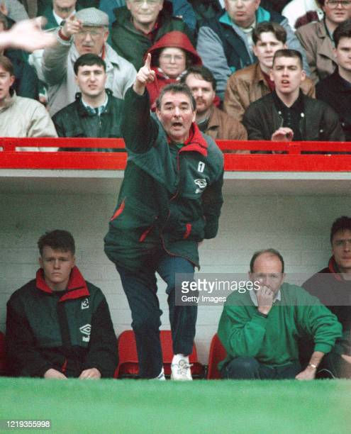 Nottingham Forest mananger Brian Clough makes a point watched by coach Archie Gemmill during a Division One Match at the City Ground circa 1990 in...
