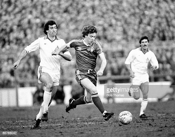 Nottingham Forest striker Tony Woodcock is chased by Cologne defender Bernd Cullmann during the European Cup Semi-Final 1st leg at the City Ground in...