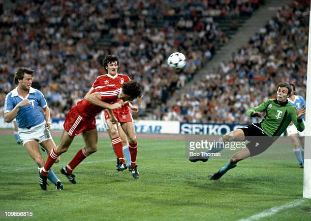 Nottingham Forest striker Trevor Francis dives to head the ball past Malmo goalkeeper Jan Moller to score the winning goal in the European Cup Final...
