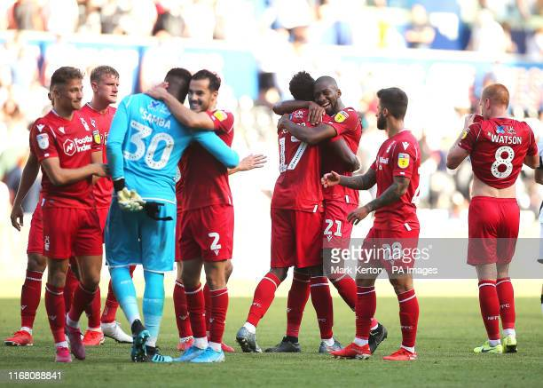 Nottingham Forest's Alfa Semedo celebrates with Samba Sow and teammates at full time during the Sky Bet Championship match at the Liberty Stadium...