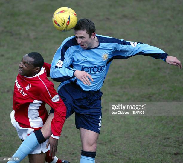 Nottingham Forest's Andy Impey and Bradford City's Gareth Farrelly battle for the ball