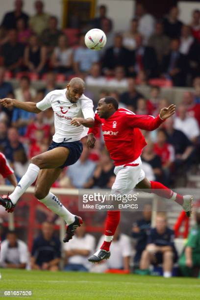 Nottingham Forest's Andy Impey and Tottenham Hotspur's Frederic Kanoute battle for the ball in the air