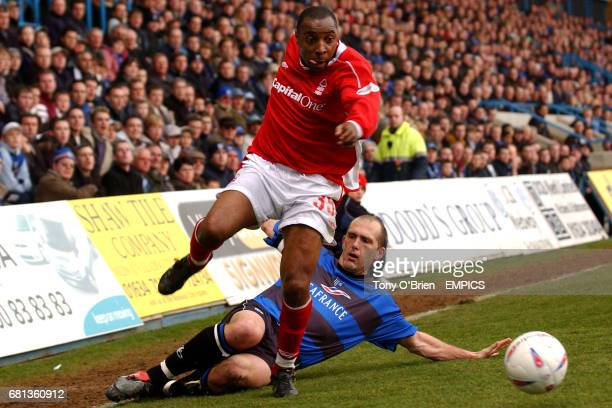 Nottingham Forest's Andy Impey evades the challenge by Gillingham's Paul Smith
