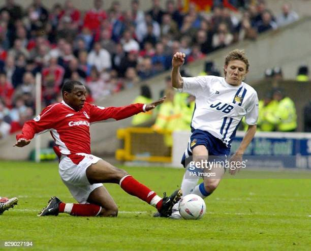 Nottingham Forest's Andy Impey slides in for a tackle on Jimmy Bullard of Wigan during the Nationwide Division One match at the City Ground...