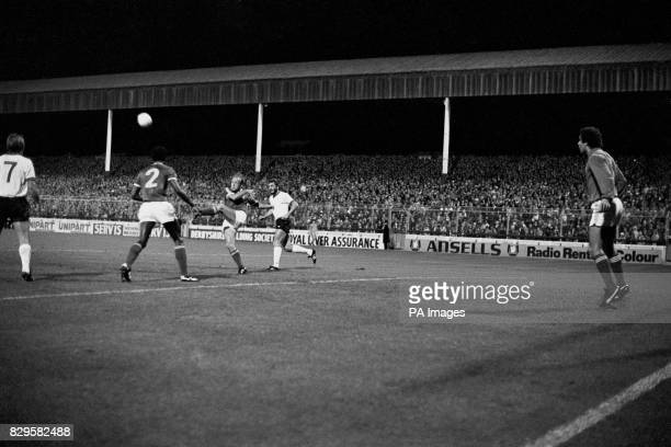 Nottingham Forest's Archie Gemmill hacks the ball clear watched by teammates Peter Shilton and Viv Anderson and Liverpool's Kenny Dalglish and Alan...