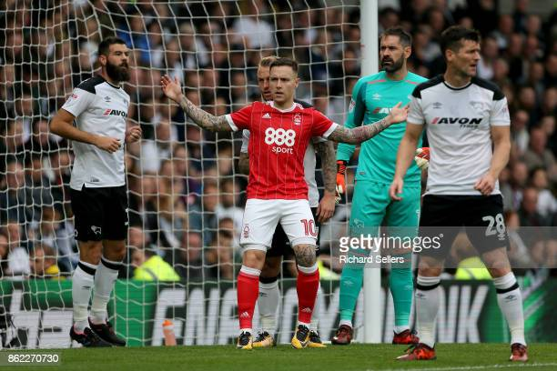 Nottingham Forest's Barrie McKay and Derby County's Johnny Russell jostle during the Sky Bet Championship match between Derby County and Nottingham...