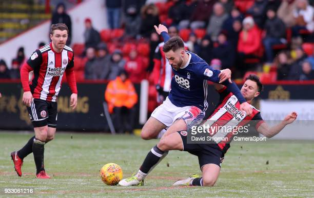Nottingham Forest's Ben Brereton is tackled by Sheffield United's George Baldock during the Sky Bet Championship match between Sheffield United and...