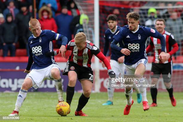 Nottingham Forest's Ben Watson battles with Sheffield United's Mark Duffy during the Sky Bet Championship match between Sheffield United and...
