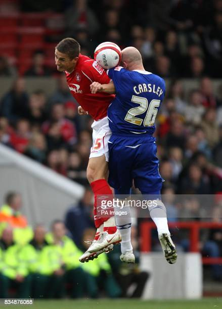 Nottingham Forest's Chris Cohen and Birmingham City's Lee Carsley battle for the ball in the air