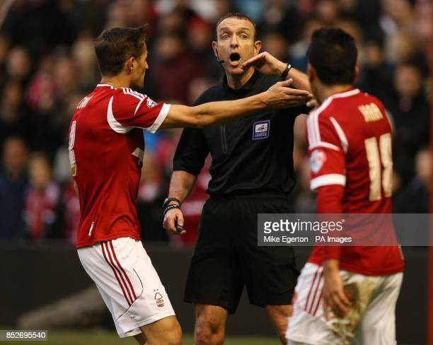 Nottingham Forest's Chris Cohen and Gonzalo Jara argue with referee Carl Boyeson after he awards a Burnley penalty during the Sky Bet Championship...