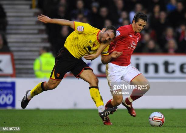 Nottingham Forest's Chris Cohen battles for the ball with Watford's John Eustace during the Npower Championship match at the City Ground Nottingham
