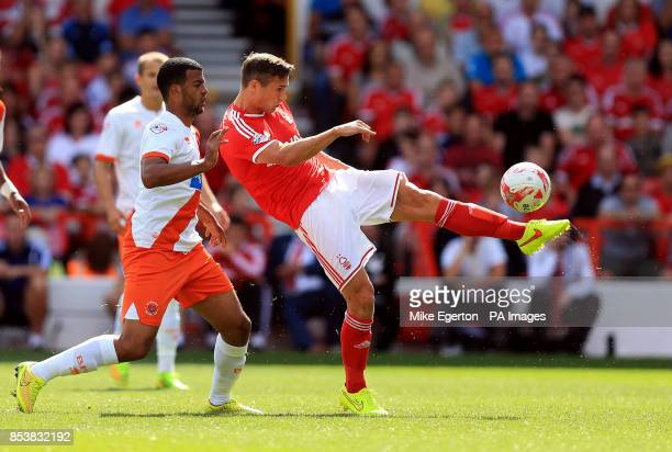 Nottingham Forest's Chris Cohen clears the ball under pressure from Blackpool's Jacob Mellis during the Sky Bet Championship match at the City Ground...