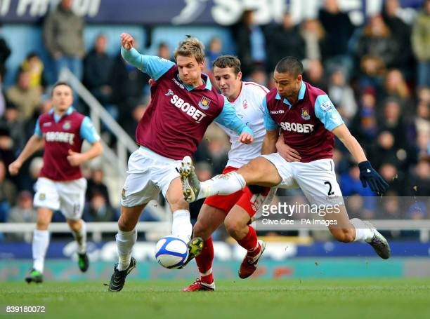 Nottingham Forest's Chris Cohen is tackled by West Ham United's Radoslav Kovac and West Ham United's Winston Reid during the FA Cup Fourth Round...