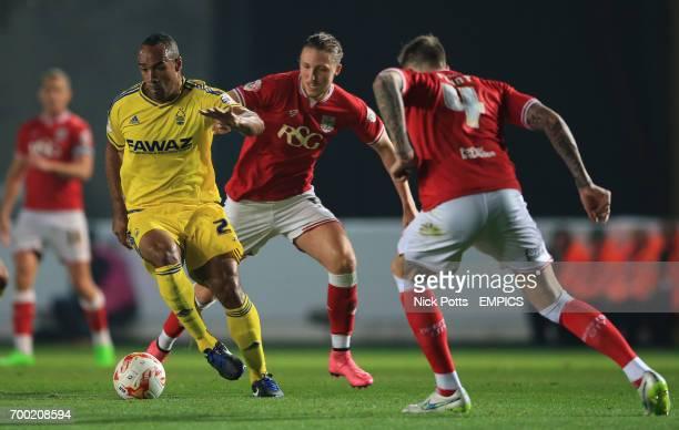Nottingham Forest's Chris O'Grady runs at Bristol City's Luke Ayling and Bristol City's Aden Flint
