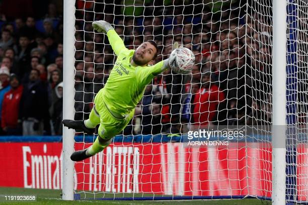 TOPSHOT Nottingham Forest's English goalkeeper Jordan Smith makes a save during the English FA Cup third round football match between Chelsea and...