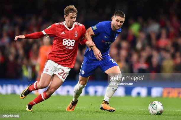 Nottingham Forest's English midfielder Kieran Dowell vies with Chelsea's English defender Gary Cahill during the English League Cup third round...