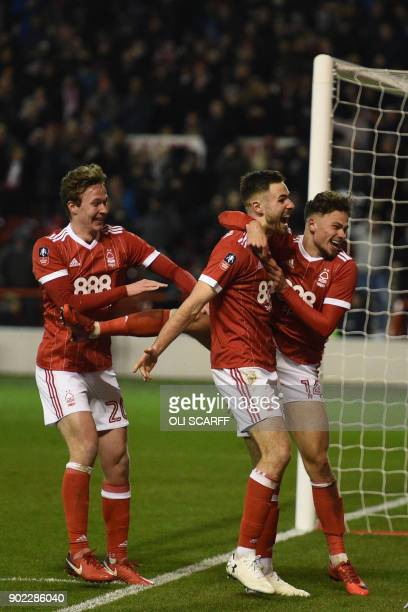 Nottingham Forest's English striker Ben Brereton celebrates scoring the penalty and the team's third goal with Nottingham Forest's English midfielder...