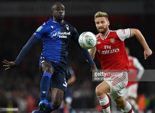 Nottingham Forest's English-born Ghanaian midfielder Albert Adomah vies with Arsenal's German defender Shkodran Mustafi during the English League Cup...