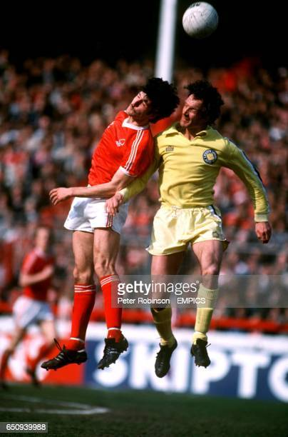 Nottingham Forest's Garry Birtles jumps with Leeds United's Paul Madeley