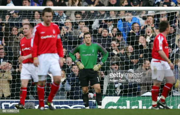 Nottingham Forest's goalkeeper Colin Doyle stands dejected after letting the ball slip throw his gloves for the opening goal scored by Jermain Defoe