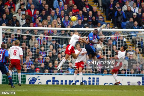Nottingham Forest's goalkeeper Darren Ward punches away a header from Crystal Palace's Darren Powell