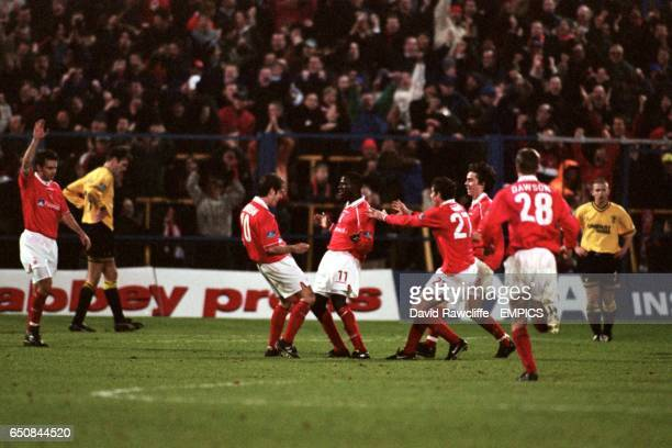 Nottingham Forest's goalscorer Chris BartWilliams celebrates with team mates Andy Johnson and Andy Gray