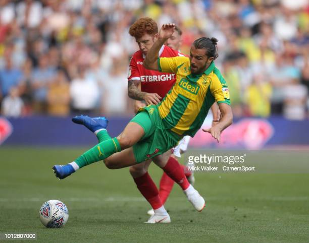 Nottingham Forest's Jack Colback battles with West Bromwich Albion's Jay Rodriguez during the Sky Bet Championship match between Nottingham Forest...