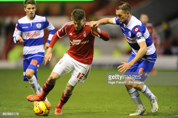 Nottingham Forest's Jamie Mackie and Queens Park Rangers Clint Hill battle for the ball during the Sky Bet Championship match at the City Ground...