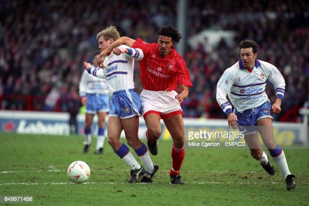 Nottingham Forest's Jason Lee holds back Luton Town's Julian James while John Dreyer also of Luton Town looks on