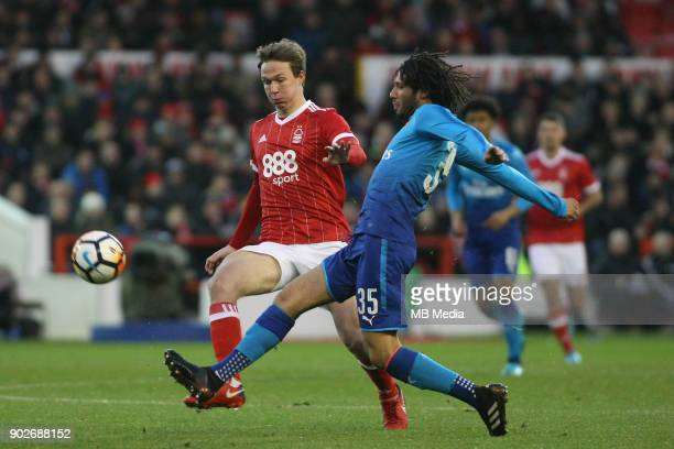 Nottingham Forest's Kieron Dowell looks to close down Arsenal's Mohammed Elneny during The Emirates FA Cup Third Round match between Nottingham...