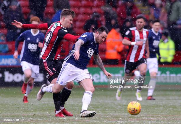 Nottingham Forest's Lee Tomlin gets away from Sheffield United's Lee Evans during the Sky Bet Championship match between Sheffield United and...