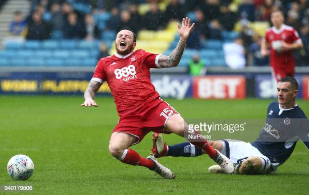 Nottingham Forest's Lee Tomlin gets tackled by Shaun Williams of Millwall during Championship match between Millwall against Nottingham Forest at The...