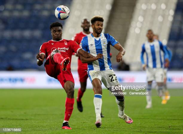 Nottingham Forest's Loic Mbe Soh clears under pressure from Huddersfield Town's Fraizer Campbell during the Sky Bet Championship match between...