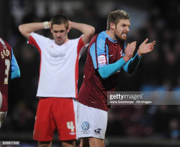 Nottingham Forest's Luke Chambers and Scunthorpe United's Paul Reid react during the npower Football League Championship match at Glanford Park...
