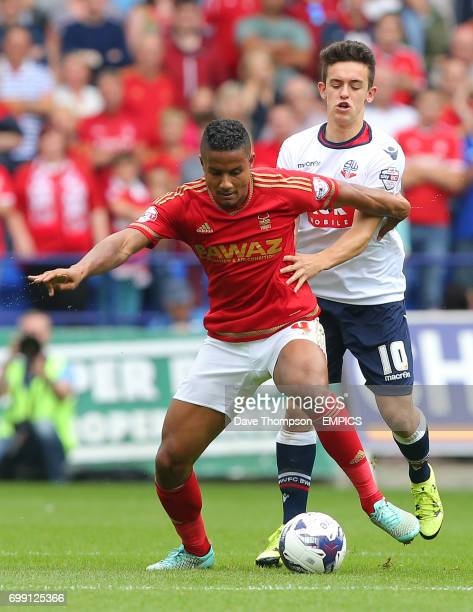 Nottingham Forest's Michael Mancienne holds off Bolton Wanderers' Zach Clough