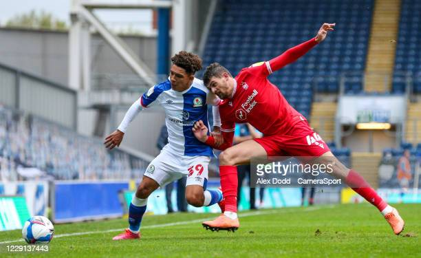 Nottingham Forest's Nicholas Ioannou battles with Blackburn Rovers' Tyrhys Dolan during the Sky Bet Championship match between Blackburn Rovers and...
