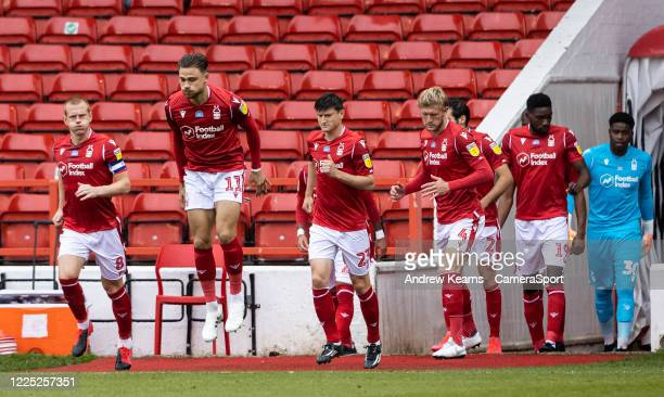 Nottingham Forest's players take to the pitch during the Sky Bet Championship match between Nottingham Forest and Fulham at City Ground on July 7,...