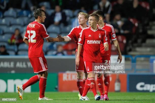 Nottingham Forest's Robert Tesche and Chris Burke celebrate after Huddersfield own goal