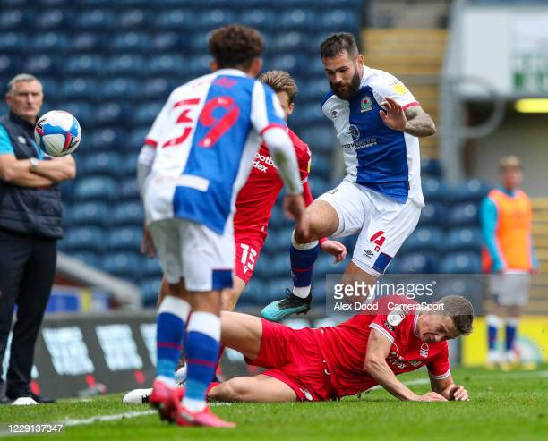 Nottingham Forest's Ryan Yates slides in on Blackburn Rovers' Bradley Johnson during the Sky Bet Championship match between Blackburn Rovers and...