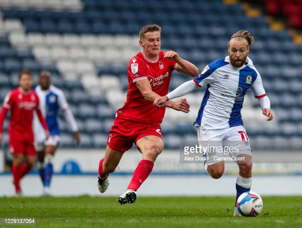 Nottingham Forest's Ryan Yates vies for possession with Blackburn Rovers' Harry Chapman during the Sky Bet Championship match between Blackburn...