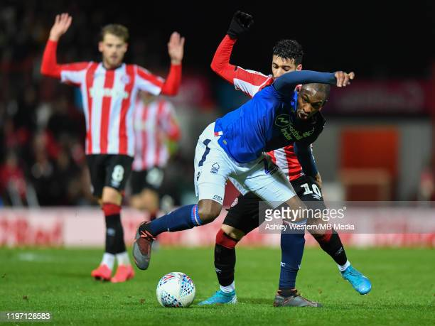 Nottingham Forest's Samba Sow holds off the challenge from Brentford's Said Benrahma during the Sky Bet Championship match between Brentford and...