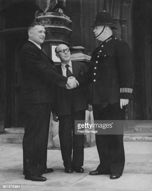 Nottingham swimmer Tom Blower is introduced to PC Mayes by Labour politician Norman Smith outside the House of Commons in London 26th July 1948...