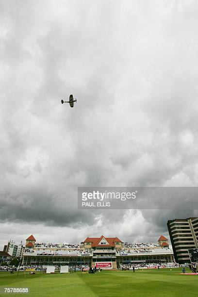 A Second World War British Spitfire aeroplane flies over Trent Bridge in Nottingham central England 27 July 2007 ahead of the first day of the second...