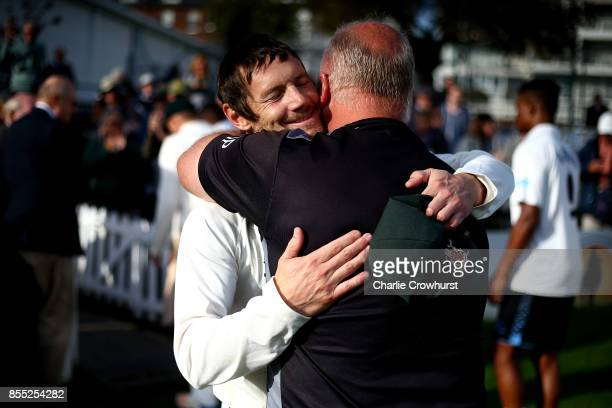 Nottingham's Chris Read celebrates with a member of coaching staff after captaining his team to promotion during day four of the Specsavers County...